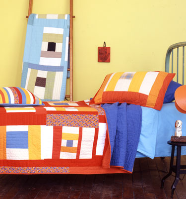 Spool Orange On a Bed